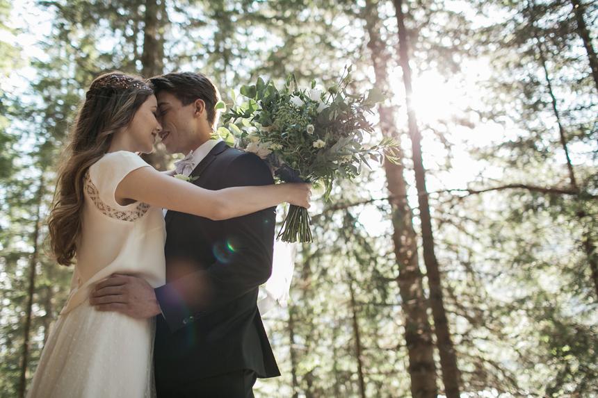 romantic wedding photo in the woods, sunset on the bridal couple, luxury wedding
