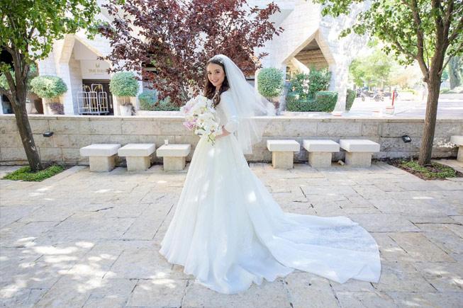 sposa vera, sposa con velo e bouquet