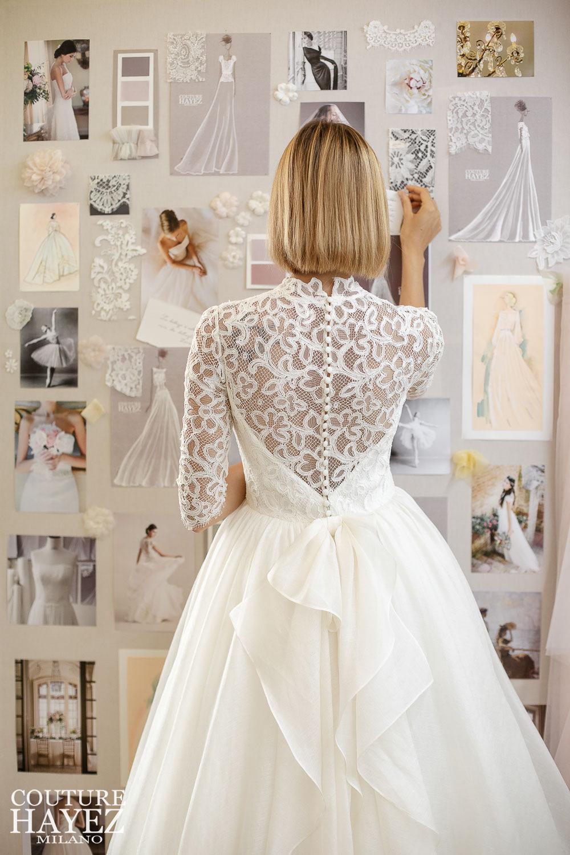 retro abito da sposa in pizzo con maniche lunghe, bottoncini e fiocco